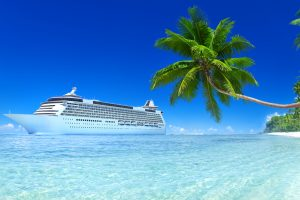Cruise ship off tropical beach • Cruises by Holiday Hamster