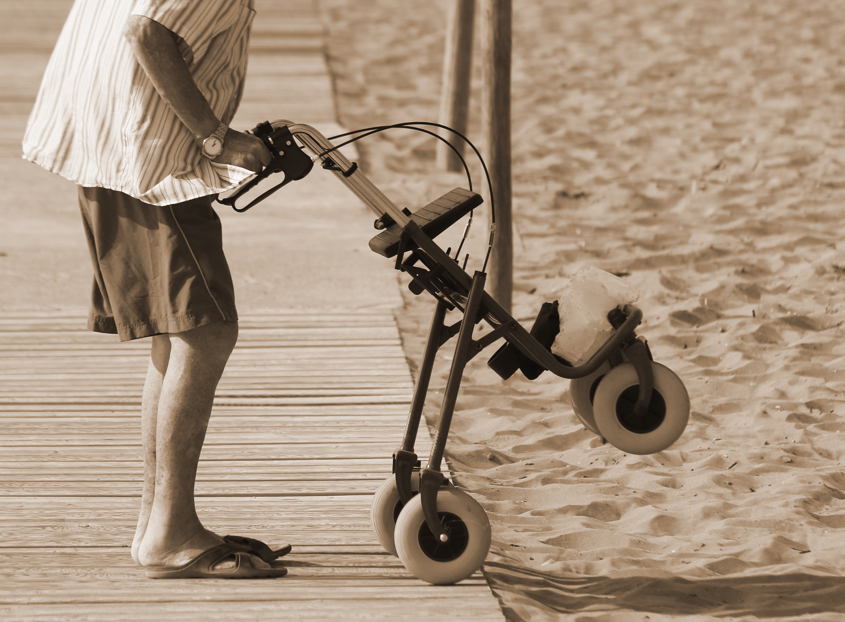 Man with walker on the beach • Disabled Holidays by Holiday Hamster