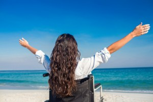 Woman in a wheelchair on a beach • Disabled Holidays by Holiday Hamster