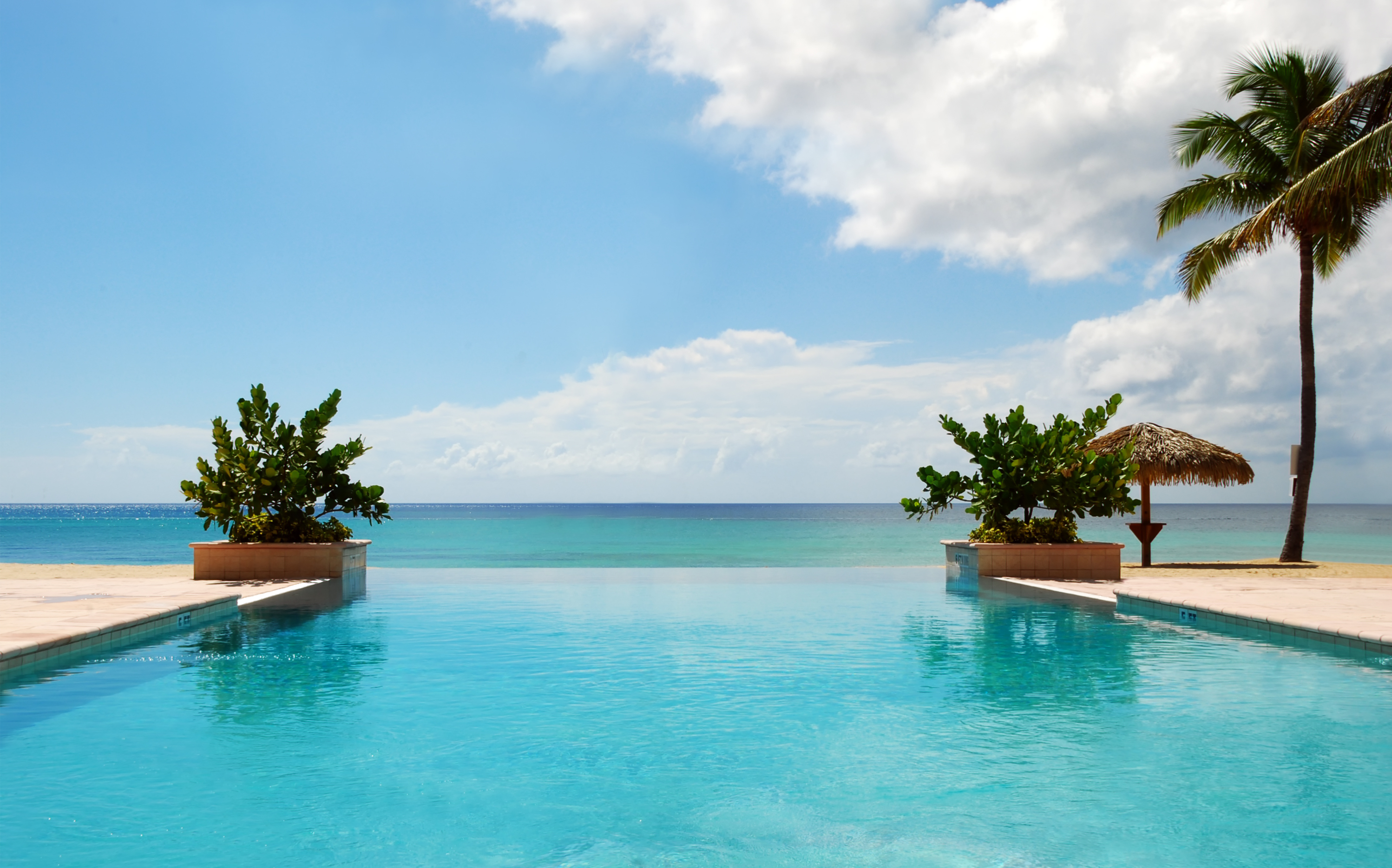 Luxury swimming pool on the beach • Luxury Holidays by Holiday Hamster