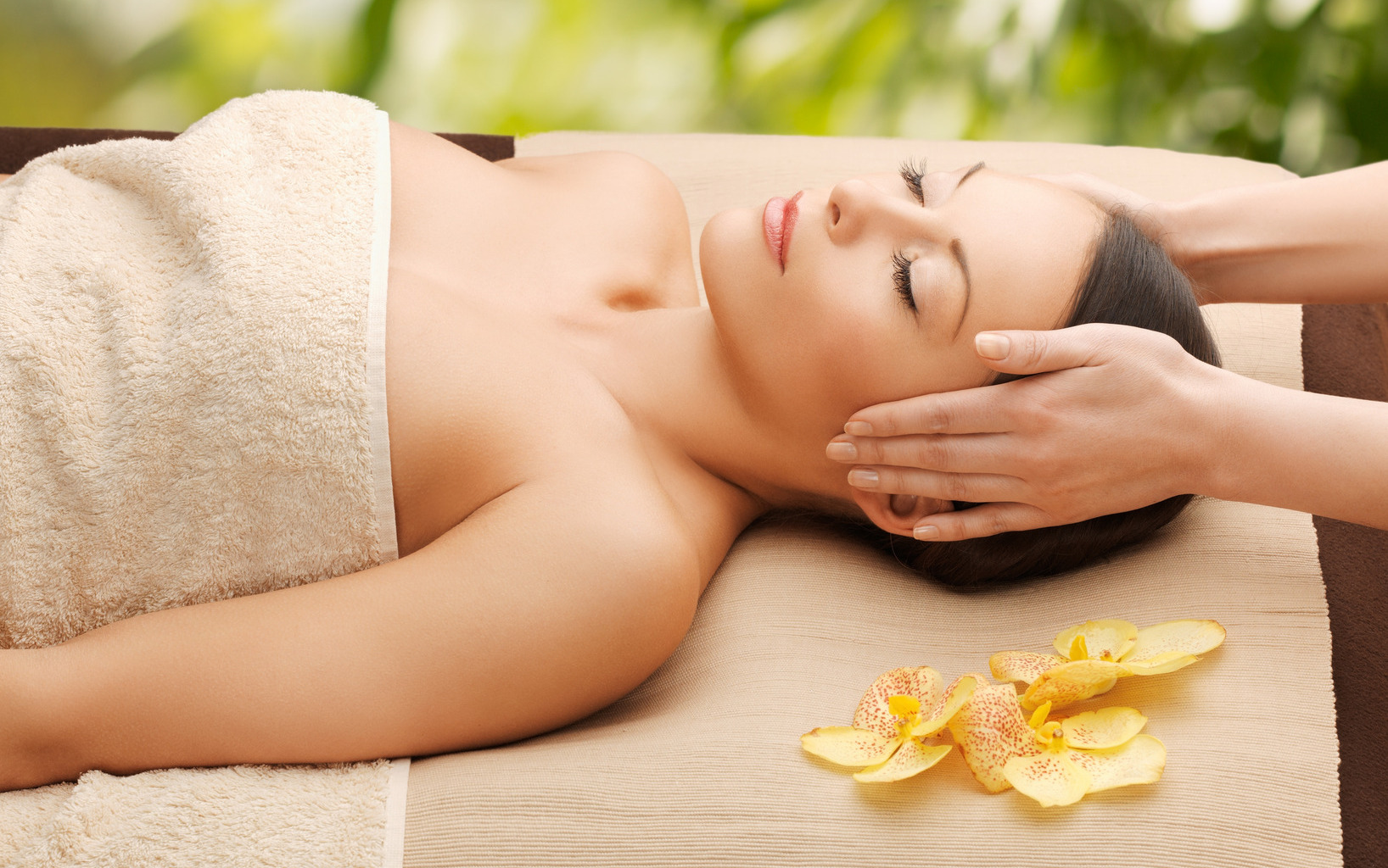 Woman in a spa getting a facial massage • Spa Holidays by Holiday Hamster