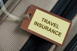 "Suitcase with the words ""Holiday Insurance"" written on label • Travel Insurance by Holiday Hamster"