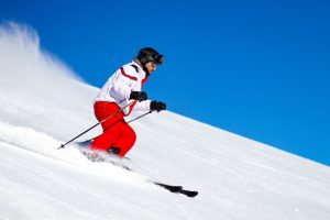 Skier speeding down a mountain ski slope • Winter Sports by Holiday Hamster