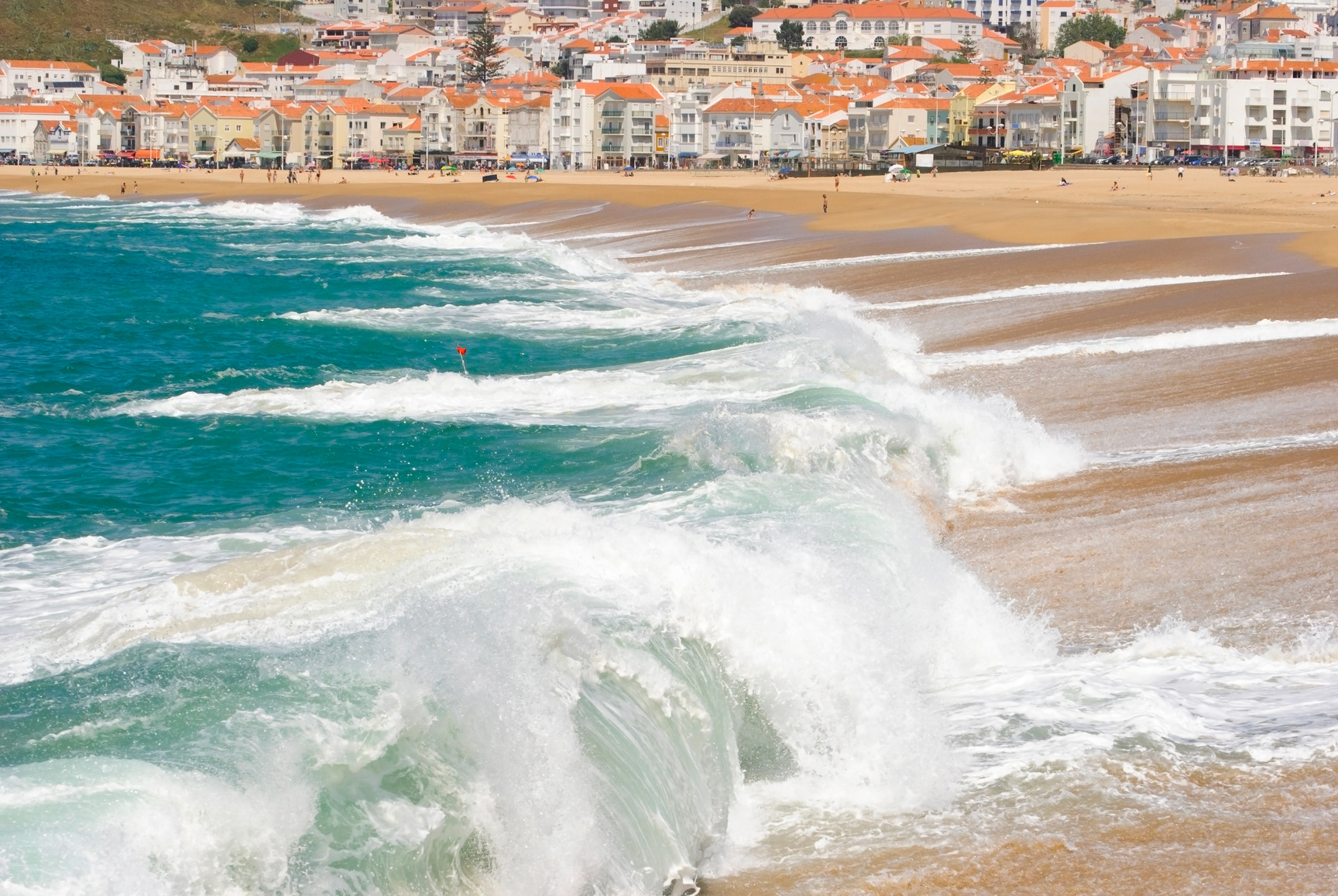 Waves crashing on a beach in Nazare, Portugal