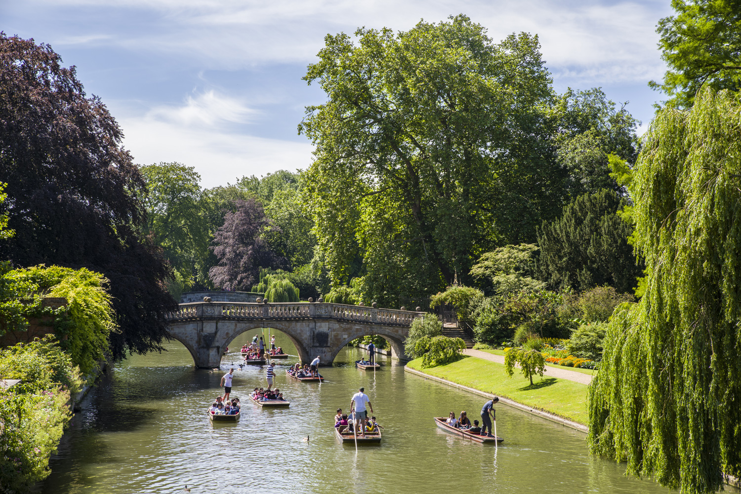 A picturesque view of Clare Bridge over the River Cam in Cambridge, UK