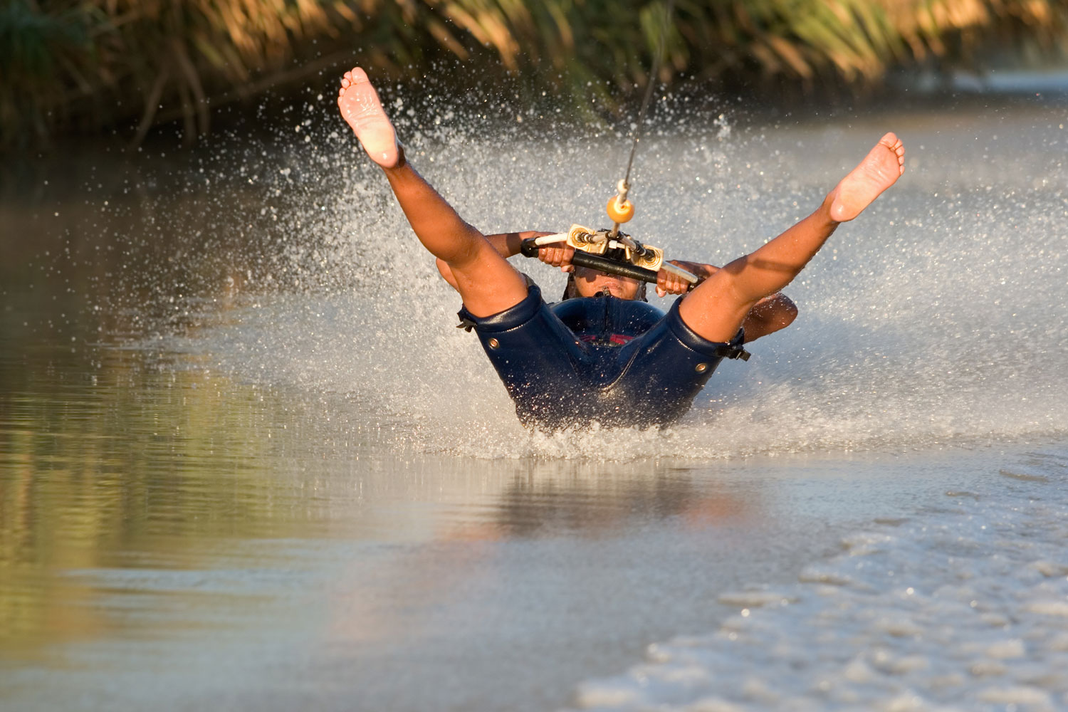 Barefoot Water Skier on her Back with Water Spray