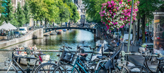 Bicycles on a bridge over a canal in Amsterdam