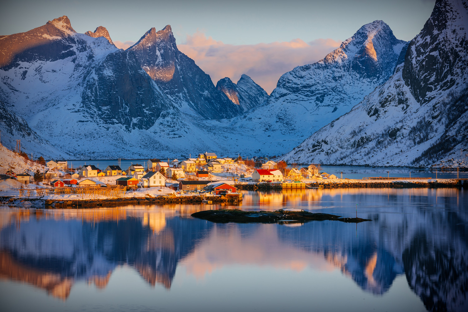 Colourful winter sunrise in the fishing village of Reine, Norway