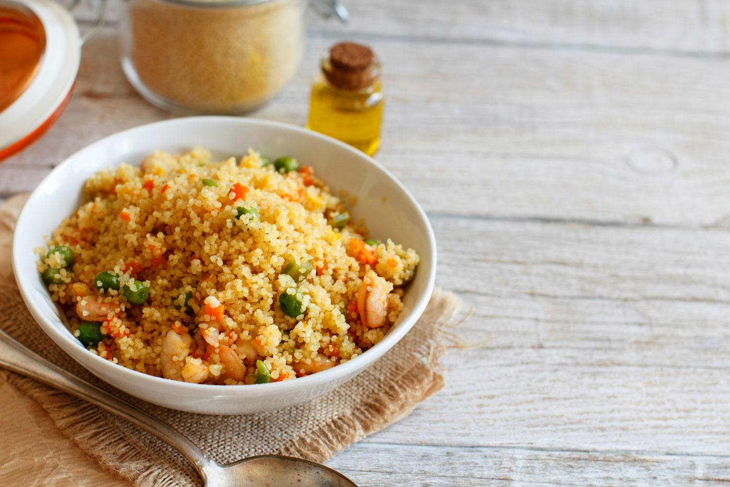 Couscous with shrimps and vegetables, served in a bowl
