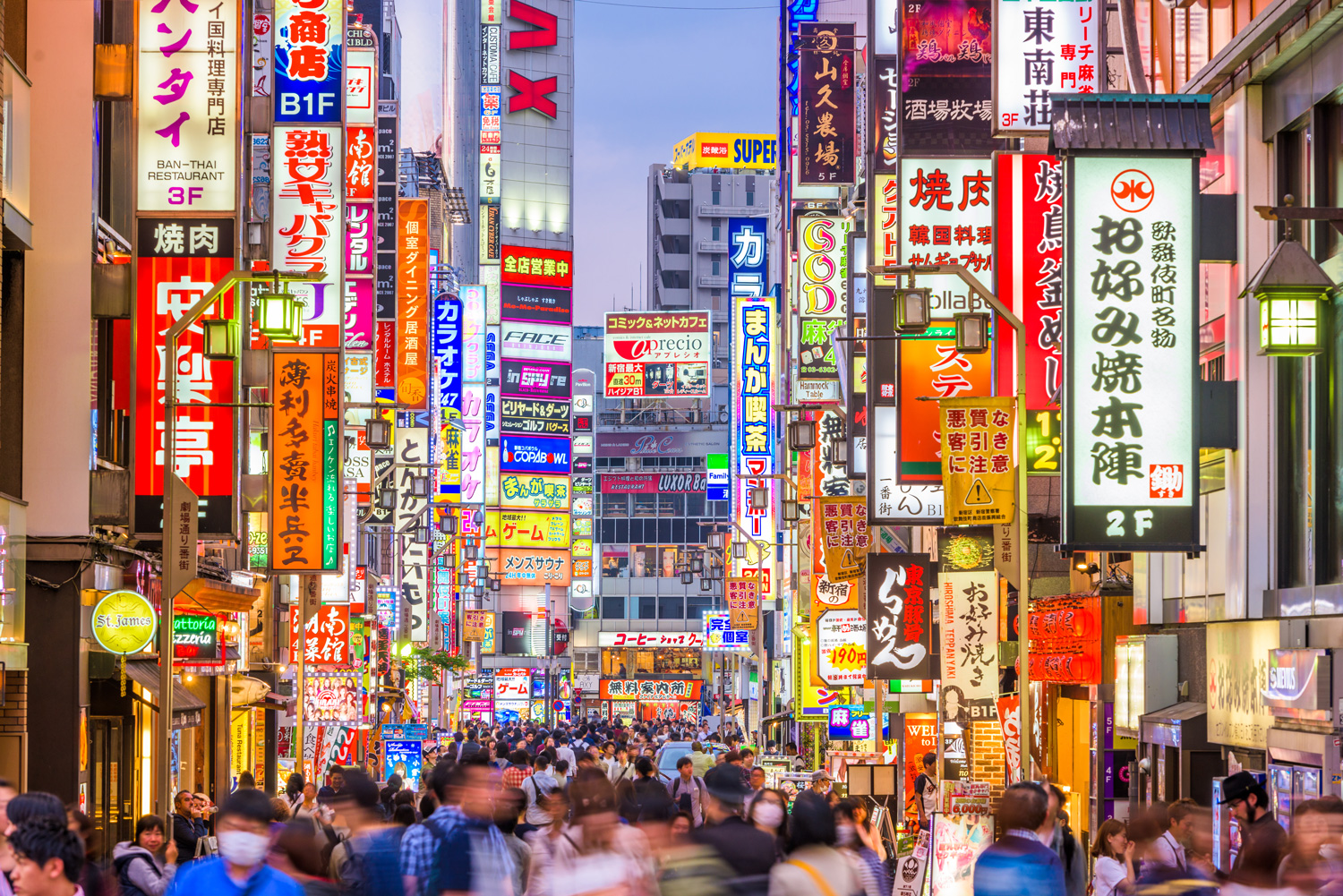 Crowds pass through Kabukicho in the Shinjuku district of Tokyo