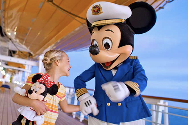 Girl with Mickey on deck of Disney Cruise Line with Holiday Hamster