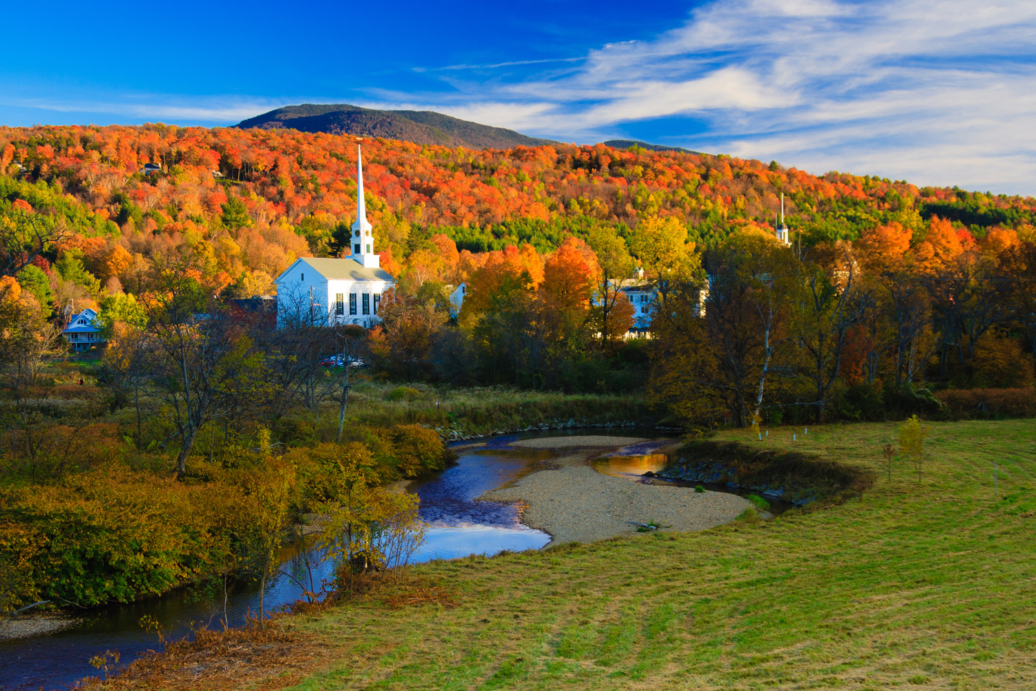 Fall Foliage surrounding the Stowe Community Church, Stowe, Vermont, USA