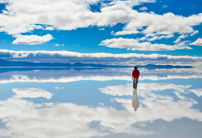 Girl in red on Salar de Uyuni in Bolivia
