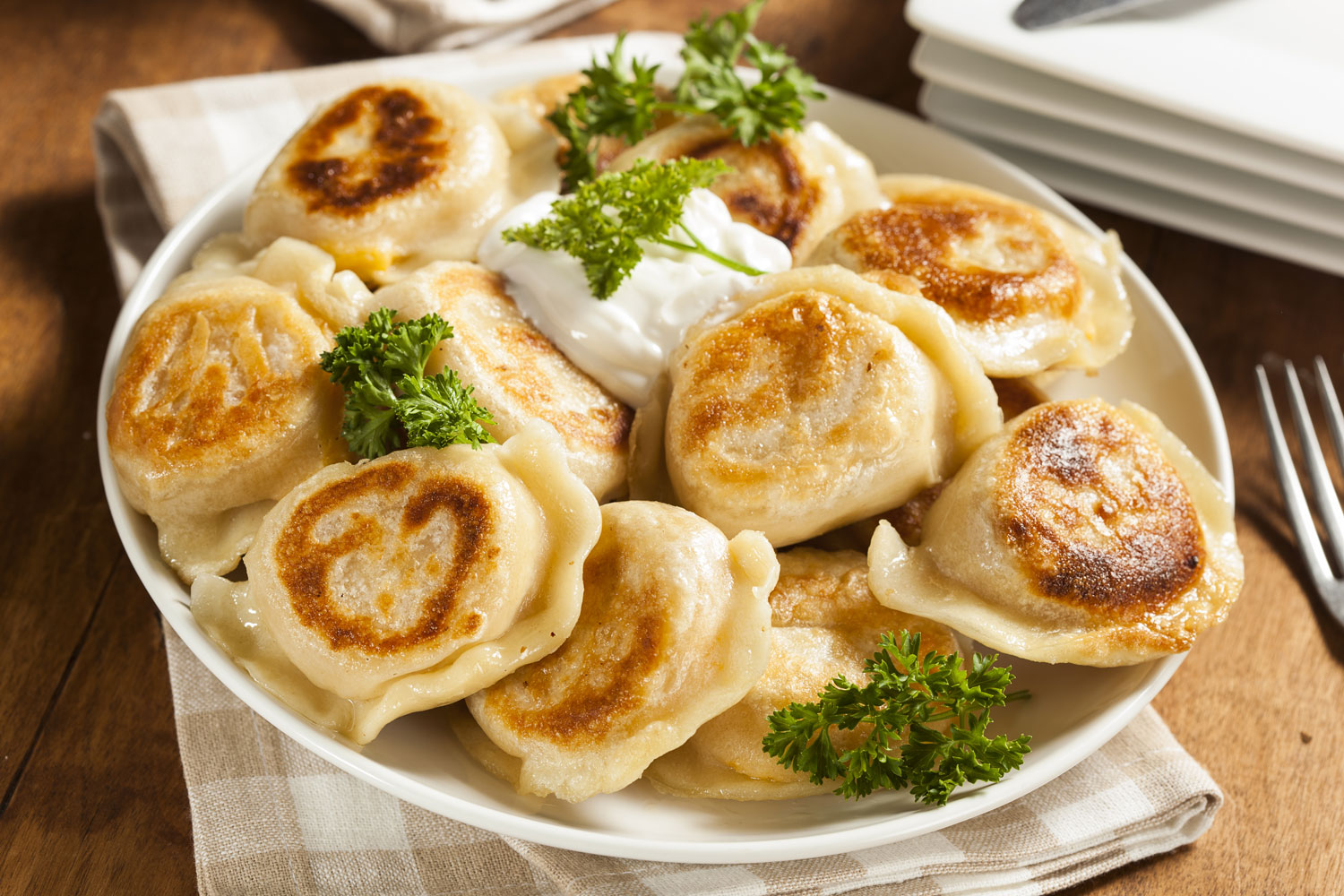 Homemade Polish Pierogis with Sour Cream and Parsley