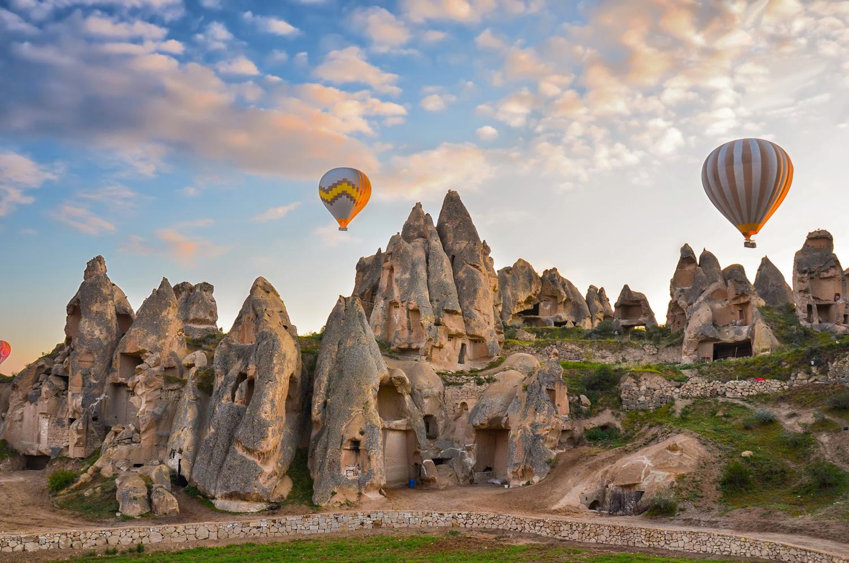 Hot air balloons flying over spectacular Cappadocia, Turkey