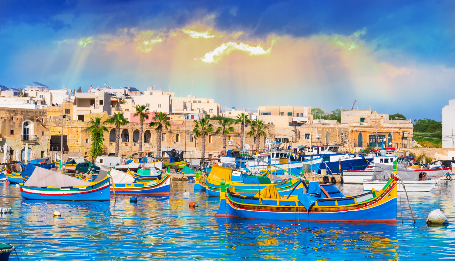 Marsaxlokk harbor, Malta, illuminated by sunset light