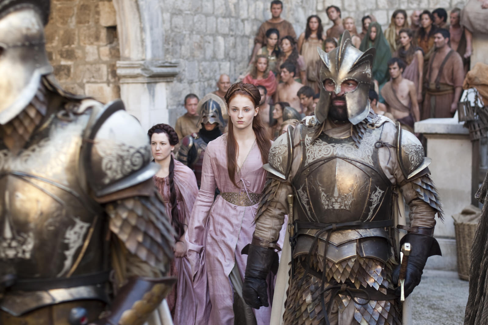 Sansa Stark is escorted through the streets of Dubrovnik
