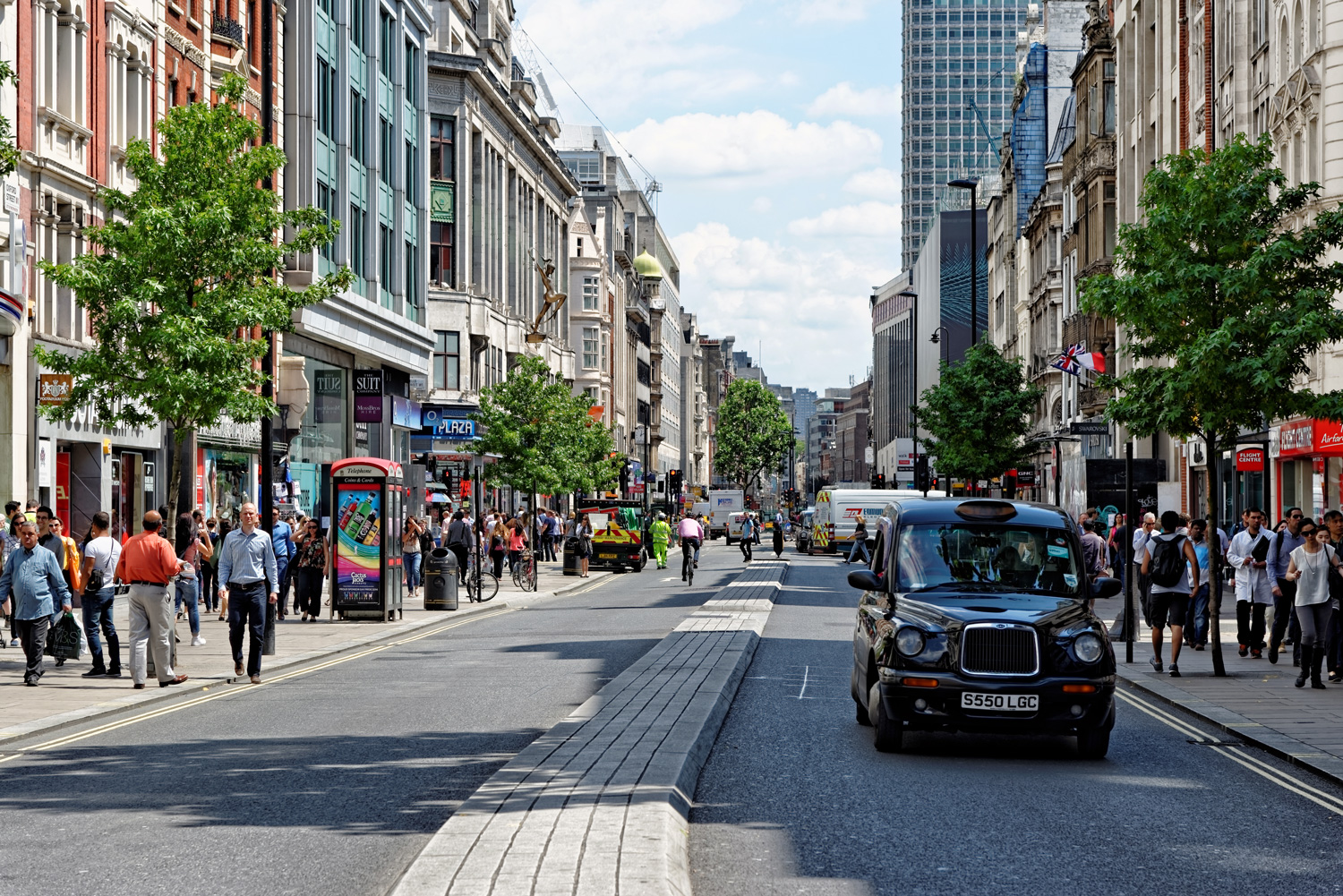 Shoppers on Oxford Street, London - the biggest shopping street in Europe