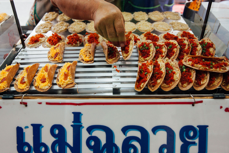 Street Vendor Selling Khanom Bueang (Thai Crepe)