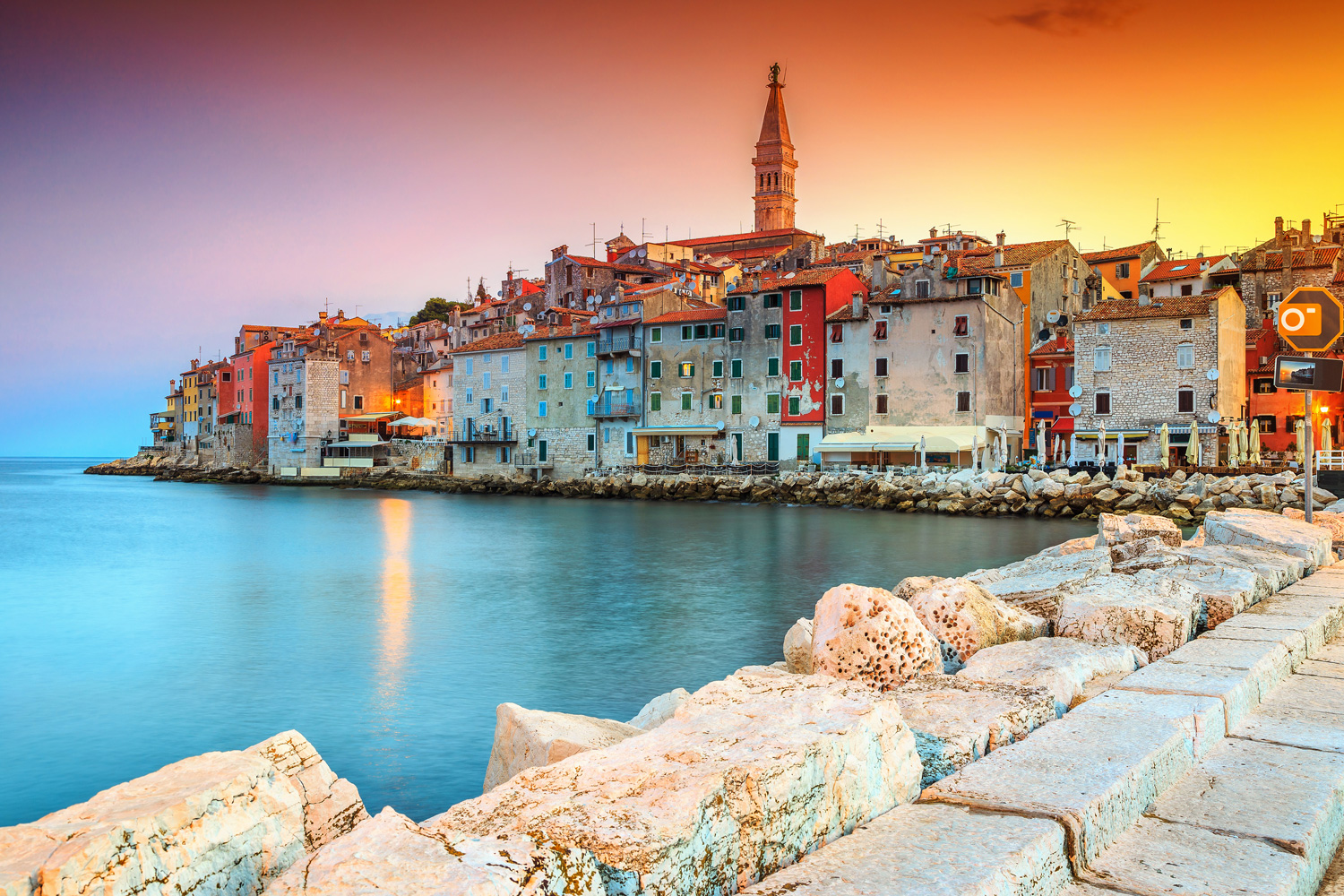Stunning romantic old town of Rovinj, Croatia with colorful buildings and a magical sunset