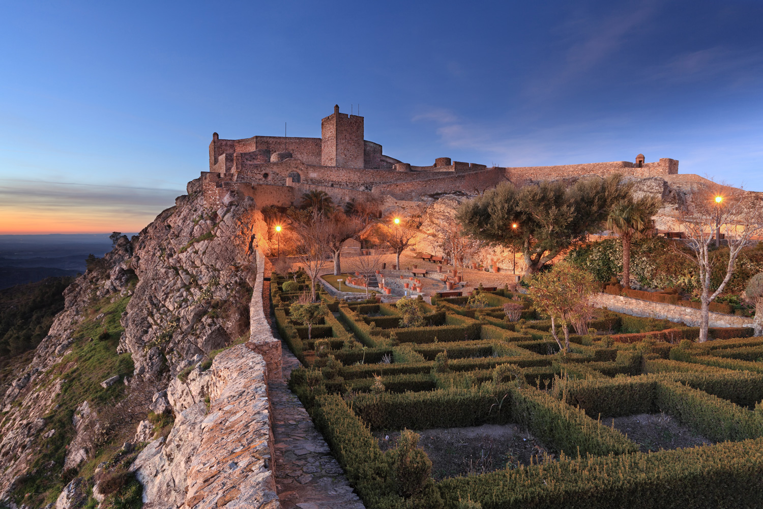The sun sets over Marvao's clifftop castle in Portugal's Alentejo region
