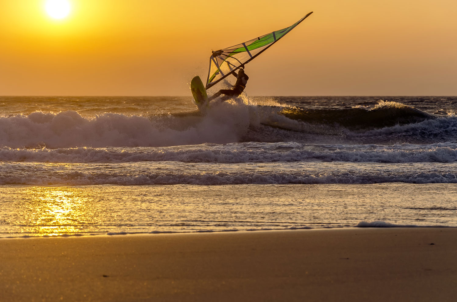 Windsurfer Speeding Fast Against the Sunset