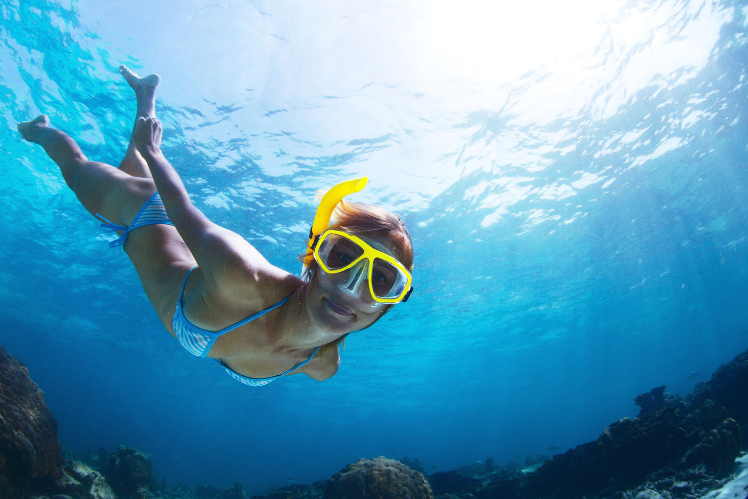 Young Lady Snorkeling and Doing Skin Diving in a Tropical Sea